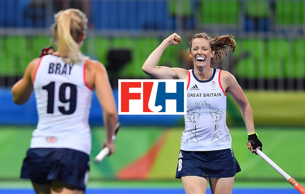 Britain's Helen Richardson-Walsh (R) celebrates a goal during the women's quarterfinal field hockey Britain vs Spain match of the Rio 2016 Olympics Games at the Olympic Hockey Centre in Rio de Janeiro on August 15, 2016. / AFP / Carl DE SOUZA        (Photo credit should read CARL DE SOUZA/AFP/Getty Images)