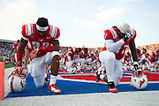 DALLAS, TX - AUGUST 30: The SMU Mustangs kneel down in the end zone before kickoff against the Texas Tech Red Raiders on August 30, 2013 at Gerald J. Ford Stadium in Dallas, Texas.  (Photo by Cooper Neill/Getty Images) *** Local Caption ***