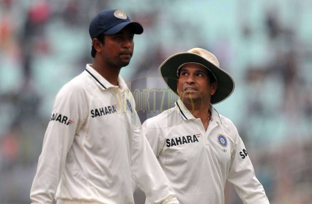 Pragyan Ojha of India and Sachin Tendulkar of India leave the ground due to bad light during the 2nd day of the 2nd test match between India and The West Indies held at Eden gardens in Kolkata, India on the 15th November 2011..Photo by Pal Pillai/BCCI/SPORTZPICS