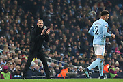 Pep Guardiola encourages Kyle Walker during the Premier League match between Manchester City and Newcastle United at the Etihad Stadium, Manchester, England on 20 January 2018. Photo by George Franks.