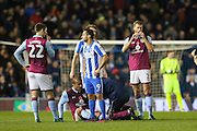 Aston Villa striker Gabriel Agbonlahor (11) lays down injured during the EFL Sky Bet Championship match between Brighton and Hove Albion and Aston Villa at the American Express Community Stadium, Brighton and Hove, England on 18 November 2016. Photo by Phil Duncan.