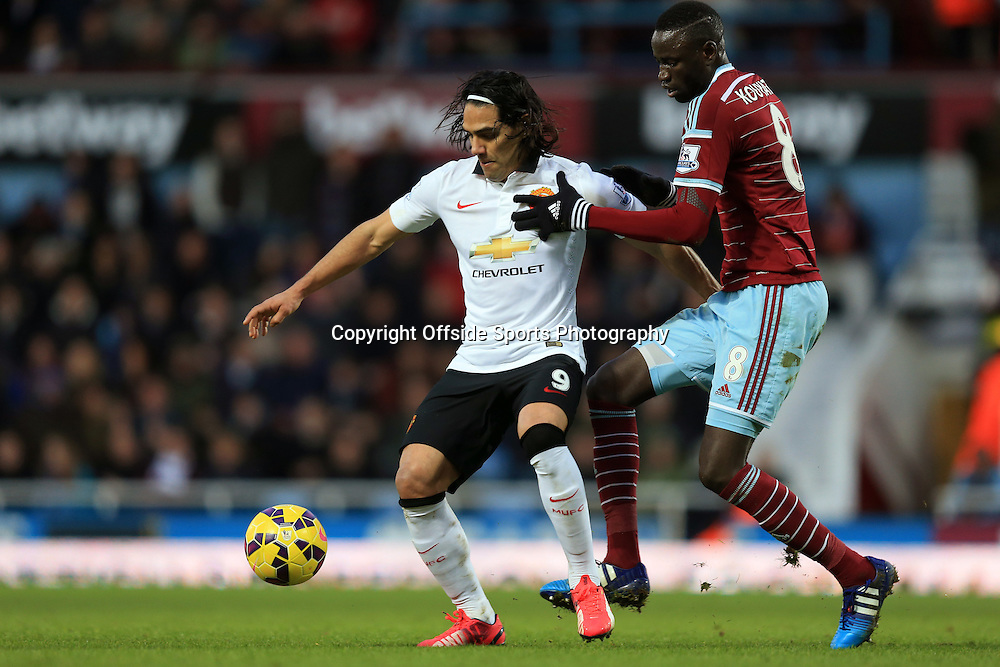 8 February 2015 - Barclays Premier League - West Ham United v Manchester United - Radamel Falcao of Manchester United tangles with Cheikhou Kouyate of West Ham - Photo: Marc Atkins / Offside.