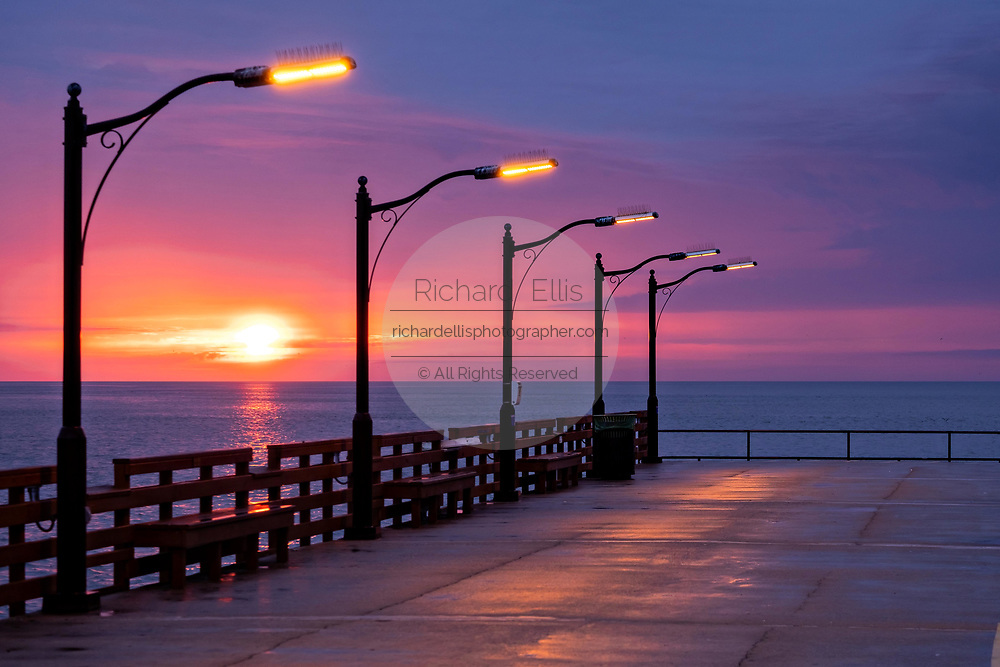 The St. Simons Public Pier at sunrise along the Saint Simons Sound in St. Simons Island, Georgia.
