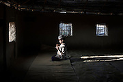 A Rohingya refugee in the mosque at the Nayapara UNHCR camp, Cox's Bazar, Bangladesh.