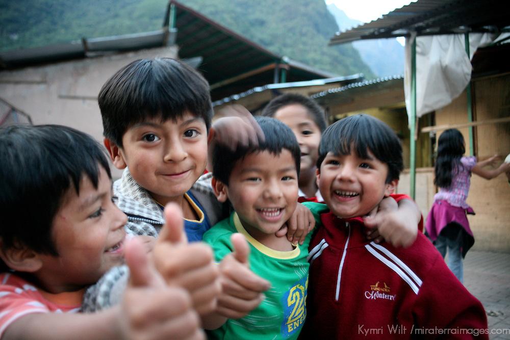 Americas, South America, Peru, Aquas Calientes. Peruvian boys at play.
