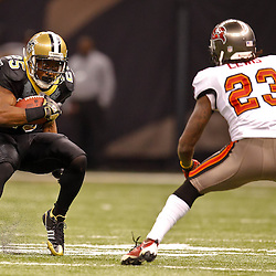 January 2, 2011; New Orleans, LA, USA; New Orleans Saints running back Reggie Bush (25) is pursued by Tampa Bay Buccaneers cornerback Myron Lewis (23) during the third quarter at the Louisiana Superdome. Mandatory Credit: Derick E. Hingle
