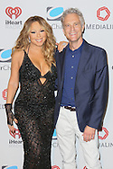 CAP D'ANTIBES, FRANCE - JUNE 17:   Mariah Carey and John Sykes – President of Entertainment Enterprises, Clear Channel attend Clear Channel Media And Entertainment And MediaLink Dinner at Hotel du Cap-Eden-Roc on June 17, 2014 in Cap d'Antibes, France.  (Photo by Tony Barson/Getty Images for Clear Channel)