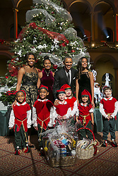 Dec. 14, 2014 - Washington, District of Columbia, United States of America - United States President Barack Obama, center right, first lady Michelle Obama, left, and daughters Sasha, center left, and Malia, right, pose with ''elves'' prior to the taping of TNT's ''Christmas in Washington'' program in Washington, D.C. on December 14, 2014. The ''elves'' are former patients of Children's National Medical Center, the beneficiary of this evenings concert. .Credit: Kristoffer Tripplaar  / Pool via CNP (Credit Image: © Kristoffer Tripplaar/CNP/ZUMAPRESS.com)