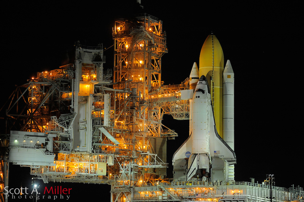 """Cape Canaveral, Florida, Sept 21, 2010; Space Shuttle Discovery sits on Launch Pad 39A for it's planned Nov. 1, 2010 launch from Cape Canaveral..Discovery has flown 38 flights, completed 5,247 orbits, and has spent 322 days in orbit. Discovery is the orbiter fleet leader, having flown more flights than any other orbiter in the fleet, including four in 1985 alone. Discovery flew all three """"return to flight"""" missions after the Challenger and Columbia disasters: STS-26 in 1988, STS-114 in 2005, and STS-121 in 2006...©2010 Scott A. Miller"""