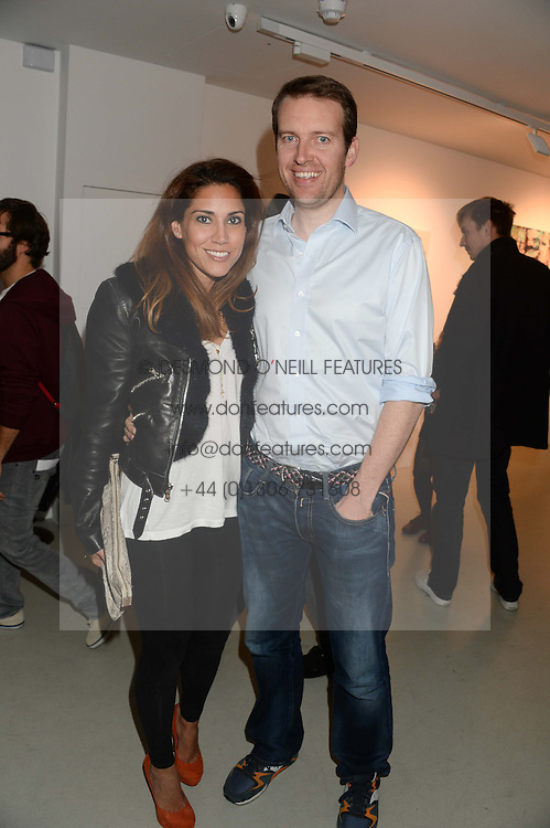 JAMES & LILY HODGES at a private view of an exhibition of paintings by Billy Zane entitled 'Save The Day Bed' held at the Rook & Raven Gallery, Rathbone Place, London on 10th October 2013.