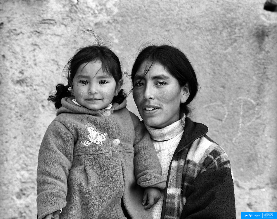 Ana Rosalia Chumacero Coroba, 29, housewife,  with daughter Katiana Ines Lopez Chumacero, 2, Potosi. Bolivia..Sitting at 4,090M (13,420 Feet) above sea level the small mining community of Potosi, Bolivia is one of the highest cities in the world by elevation and sits ?sky high? in the hills of the land locked nation. Overlooking the city is the infamous mountain, Cerro Rico (rich mountain), a mountain conceived to be made of silver ore. It was the major supplier of silver for the spanish empire and has been mined since 1546, according to records 45,000 tons of pure silver were mined from Cerro Rico between 1556 and 1783, 9000 tons of which went to the Spanish Monarchy. The mountain produced fabulous wealth and became one of the largest and wealthiest cities in Latin America. The Extraordinary riches of Potosi were featured in Maguel de Cervantes famous novel Don Quixote. One theory holds that the mint mark of Potosi, the letters PTSI superimposed on one another is the origin of the dollar sign. Today mainly zinc, lead, tin and small quantities of silver are extracted from the mine by over 100 co-operatives and private mining companies who still mine the mountain in poor working conditions, children are still used in the mines and the lack of protective equipment and constant inhalation of dust means miners have a short life expectancy with many contracting silicosis and dying around 40 years of age. UNESCO designated the historic city a World Heritage site in 1987. Most of Potosí's colonial churches have been restored, and tourism has increased. Potosi, Bolivia. 16th September 2011. Photo Tim Clayton