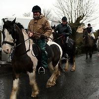 Horses and riders make their way out despite the bad conditions at the Ballinruan Hunt on Saturday.<br /> Photograph by Yvonne Vaughan