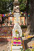 A grave decorated for the Dead of the Dead during the Dia de Muertos festival at the old San Juan de Dios cemetery in San Miguel de Allende, Mexico. The multi-day festival is to remember friends and family members who have died using calaveras, aztec marigolds, alfeniques, papel picado and the favorite foods and beverages of the departed.