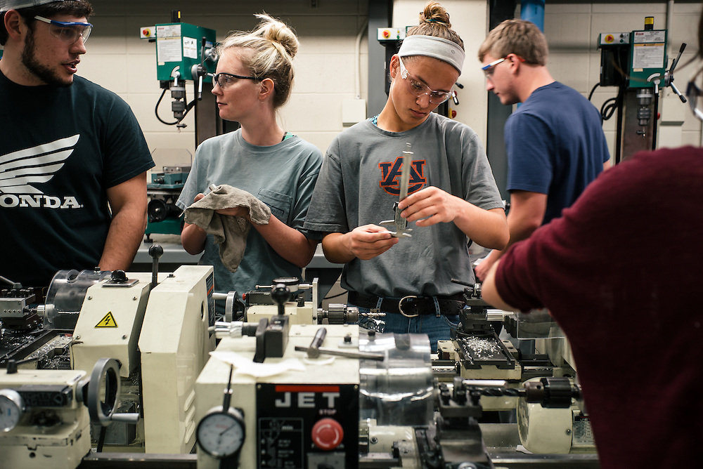 AUBURN, AL – NOVEMBER 20, 2016: Auburn University undergraduate students work on their final projects in Dr. Lewis Payton's Design and Manufacturing Laboratory.<br /> <br /> In much of the United States, global trade and technological innovation has failed to produce the prosperity hoped for by political and business leaders. Yet despite formidable economic challenges, some localities are flourishing. In Lee County, Ala., unemployment is below the national average despite the loss of thousands of manufacturing jobs, and the key to the county's resilience may be Auburn University, which provided a steady source of employment during recessions and helped draw new businesses to replace those that fled. <br /> CREDIT: Bob Miller for The Wall Street Journal<br /> [RESILIENT]