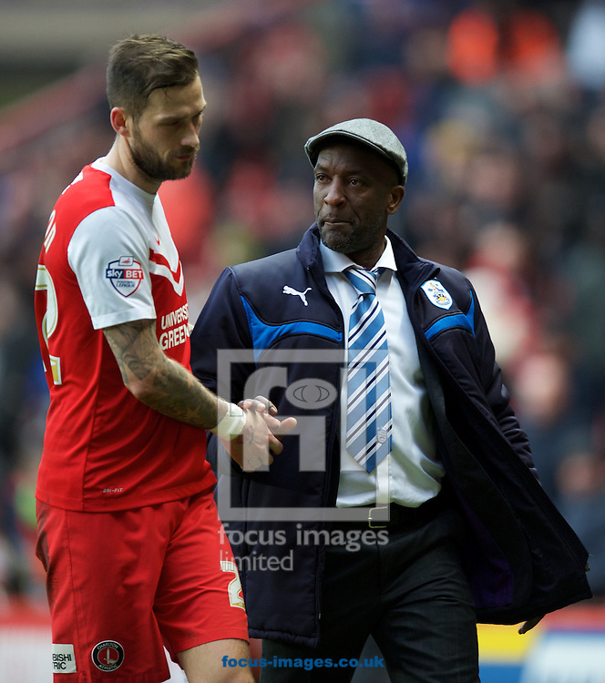 Roger Johnson of Charlton Athletic comes off with Manager Chris Powell of Huddersfield Town after the Sky Bet Championship match at The Valley, London<br /> Picture by Alan Stanford/Focus Images Ltd +44 7915 056117<br /> 28/02/2015
