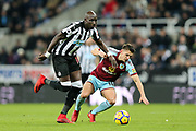 Mohamed Diame (#10) of Newcastle United steps in to steal the ball from Ashley Westwood (#18) of Burnley during the Premier League match between Newcastle United and Burnley at St. James's Park, Newcastle, England on 31 January 2018. Photo by Craig Doyle.