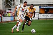 MKDons defender Baily Cargill (26) goes past Cambridge United's Jevani Brown(20) during the EFL Sky Bet League 2 match between Cambridge United and Milton Keynes Dons at the Cambs Glass Stadium, Cambridge, England on 13 October 2018.