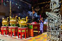 YANGON, MYANMAR -NOVEMBER 25, 2016 : woman praying at Chinese Kheng Hock Keong Temple Yangon (Rangoon) in Myanmar (Burma)