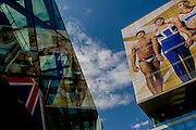 The giant presence of Team GB role-model athlete heroes on the side of the their HQ at the Westfield City shopping complex, Stratford that leads to the Olympic Park during the London 2012 Olympics, the 30th Olympiad. The ad is for sports footwear brand Adidas and their 'Take The Stage' campaign. The faces include diver Tom Daley, gymnast Louis Smith and the darling of British athletics, heptathlete gold medallist Jessica Ennis ..