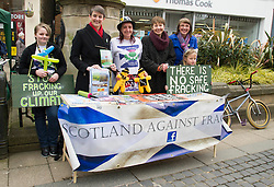 Pictured: Trish Buchan (hat) with her daughters Rachel (left) and Rebecca (right) met Maggie Champmand,  Caroline Lucas and Kirsten Robb, Greens candidate for Cantral Scotland as they manned the ir anti-fracking stall.<br /> <br /> As part of her visit to Scotland to support Greens candidates in the Scottish election, Green MP Caroline Lucas joined Scottish Greens colleagues Maggie Chapman, Greens co-convener, Mark Ruskell, candidate for Mid Scotland and Fife, Kirsten Robb, candidate for Central Scotland and John Wilson, candidate for Central Scotland, to meet anti-fracking campaigners in Falkirk <br /> <br /> Ger Harley | EEm 29 April 2016
