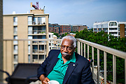 "WASHINGTON DC - June, 9:<br /> <br /> Carl Cole, a resident of the Historic Southwest Waterfront neighborhood, is pleased with the new District Wharf development in Washington DC. He's photographed on the balcony of his apartment Saturday, June 9, 2018. He lived in the same neighborhood before the Urban Renewal in the 1950's displaced the vibrant African American working-class community. <br /> <br /> The Wharf is DC's latest attempt to be a ""real"" city. It took multiple agencies and act of congress to get it built. Did they repeat the mistakes of urban renewal (which moved lower income people out of the neighborhood)? Yes and no. People will still be driven out, but this time around the neighborhood is integrated more.<br /> (Photo by Matt Roth for The Washington Post)"