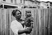 "BIRMINGHAM, AL – MAY 20, 2016: Marquita Smiley, 33, holds her 2-year-old son Zaidan in the backyard.<br /> <br /> While pregnant in 2014, Marquita Smiley was prescribed Zofran to help her cope with severe morning sickness. At her 20 week ultrasound, the OB/GYN discovered signs that her son was suffering from hypoplastic left heart syndrome – a rare heart defect resulting in a severely underdeveloped heart. Months later, her newborn Zaidan was placed on a transplant list, and he ultimately underwent surgery as a 2-month-old to replace the failed organ.<br /> <br /> Initially developed as a drug to help cancer patients suffering from the side-effects of chemotherapy, Zofran (generic name ondansetron) has become widely prescribed by doctors to treat morning sickness among pregnant mothers. Pharmaceutical companies point to studies that deny any link between the drug and birth defects, yet somehow ondansetron has avoided the strict barrier of clinical trials required by the Food and Drug Administration to validate its use among pregnant women. Absent of any data, critics argue that pregnant women and their babies are susceptible to unknown risks.<br /> <br /> It wasn't until months after Zaidan's heart transplant that the Zofran controversy was brought to Marquita Smiley's attention. ""Mentally more than anything it was life changing,"" Smiley said. ""We watched him code several times, so I really don't want anybody to have to experience this. If [the drug] is what caused it, people need to know what they're getting into."""