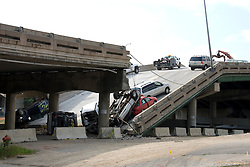Minnesota, Twin Cities, Minneapolis-Saint Paul: 35 West Bridge Collapse in August 2007, cars on bridge..Photo mnqual246-75171..Photo copyright Lee Foster, www.fostertravel.com, 510-549-2202, lee@fostertravel.com.