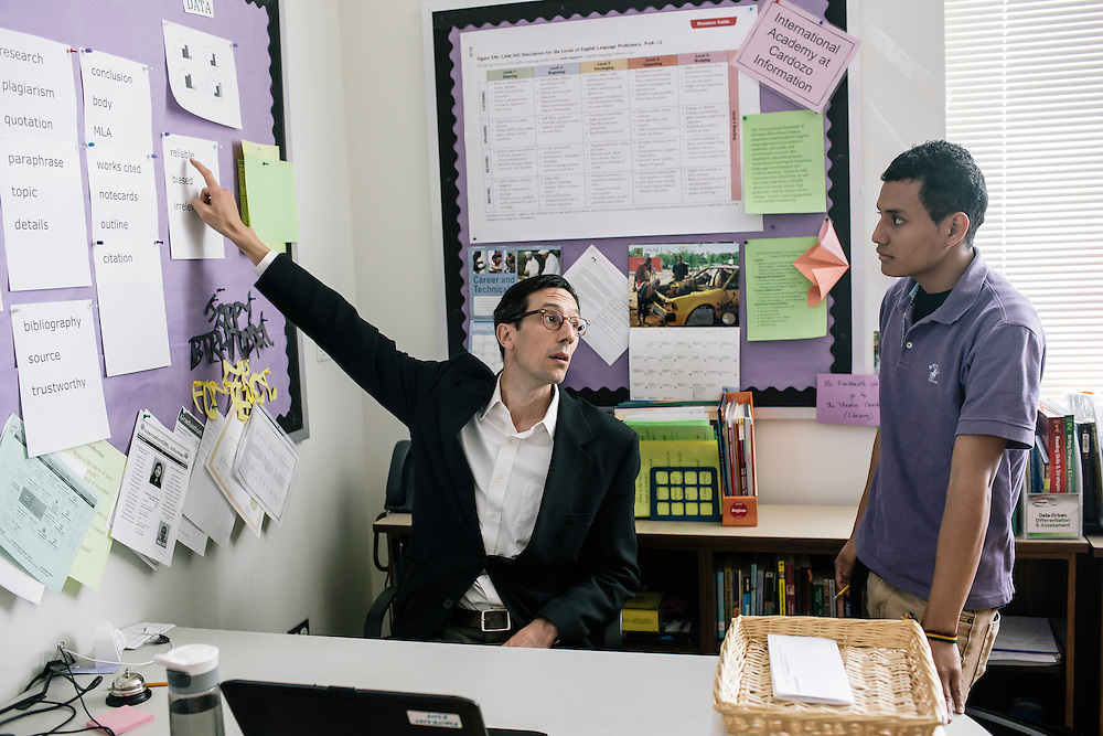 Marvin Diaz, right, a student in Washington D.C.'s first-year International Academy for English-language learners, talks with his teacher Jeff Fontenot about research methods during class at the International Academy at Cardozo Education Campus on April 22, 2015. The program is aimed at dealing with the influx of unaccompanied minors, mostly teenage males from Central American countries, and allows them to be in classes of 25 together. Currently Cardozo, in NW Washington D.C. has about 200 of these students.