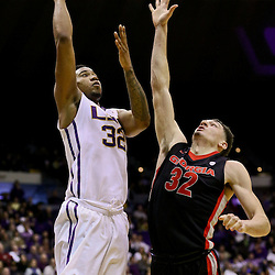 Jan 26, 2016; Baton Rouge, LA, USA; LSU Tigers forward Craig Victor II (32) shoots over Georgia Bulldogs forward Mike Edwards (32) during the first half of a game at the Pete Maravich Assembly Center. Mandatory Credit: Derick E. Hingle-USA TODAY Sports