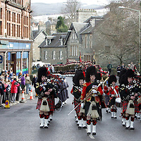 Black Watch Homecoming Parade, Aberfeldy. 02.03.05<br />Two guards of a hundred men each from The 1st Battalion The Black Watch march through Aberfeldy, Perthshire led by the Pipes and Drums also of the 1st Battalion The Black Watch. Aberfeldy is where the 'Companies' of men were mustered in 1667, the dark tartans that the men wore to distinguish them from the 'Red Soldiers' led them to becoming known as 'Freiceadan Dubh' or 'The Black Watch'<br />The Black Watch memorial in Aberfeldy was unveiled on the 14th November 1887 by Gavin - Marquis of Breadlabane.<br />Picture by Graeme Hart.<br />Copyright Perthshire Picture Agency<br />Tel: 01738 623350  Mobile: 07990 594431