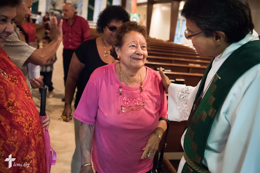 The Rev. Adolfo Borges, associate pastor at Prince of Peace Lutheran Church in Orlando, Fla., greets Isaias Rodriguez following worship at the church on Sunday, Sept. 13, 2015. LCMS Communications/Erik M. Lunsford