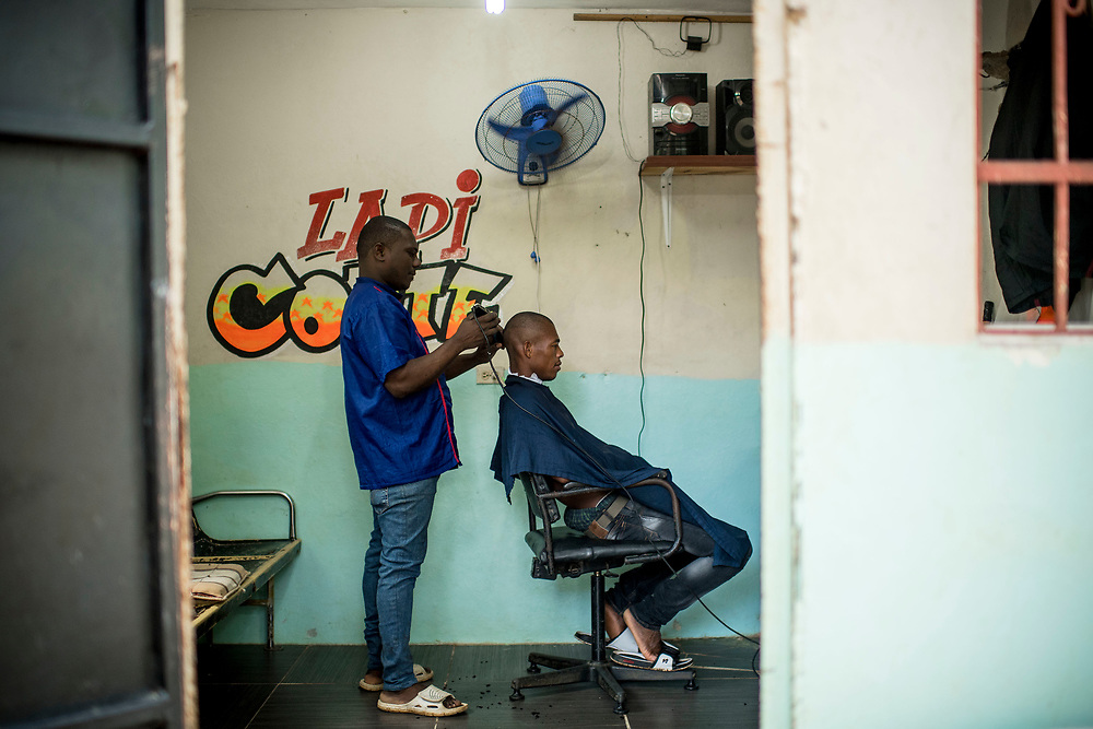 July 23, 2017, El Mamon, Dominican Republic:<br /> A barber cuts a man's hair in El Mam&oacute;n during the 2017 Lindos Sue&ntilde;os trip in the Dominican Republic Sunday, July 23, 2017. <br /> (Photo by Billie Weiss/Boston Red Sox)