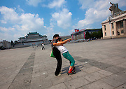 Sunday in North Korea<br /> <br /> What can you do on sunday when you live in a dictatorship? You can hardly fly outside of the for a week end, or take your car to the beach...<br /> So this is the time to enjoy simple activities for the north koreans and the best opportunity for foreigners to meet them as everyone is more relax, including your minders!<br /> <br /> Photo shows:   Roller skating is very popular for few years, since China has invaded the country with products. The huge Kim Il Sung square in Pyongyang is perfect to learn.<br /> &copy;Eric Lafforgue/Exclusivepix Media