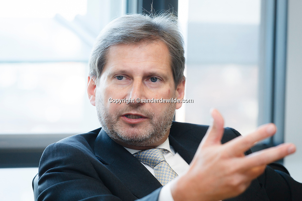 Johannes Hahn, European Commissioner for Regional Policy. Portrait with hand