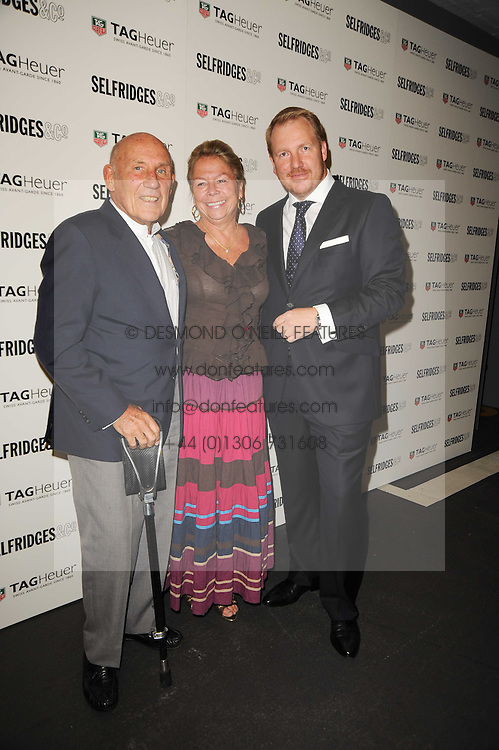 Left to right, SIR STIRLING & LADY MOSS and ROB DIVER Brand Director at TAG Heuer at a party to celebrate 150 years of TAG Heuer held at the car park at Selfridge's, London on 15th September 2010.