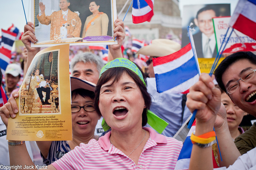 "Apr. 18, 2010 - Bangkok, Thailand: Pink Shirt peace demonstrators hold up photos of the Thai Monarch, King Bhumibol Adulyadej, during a rally against the Red Shirts Sunday. Thousands of so called ""Pink Shirts"" jammed the area around Victory Monument in Bangkok to show support the Thai Monarch, King Bhumibol Adulyadej, and against the Red Shirts, who are demonstrating just a few kilometres away in the Ratchaprasong area. The Pink Shirts claim to not support either of the other political factions who wear colors - the Red Shirts, who support deposed Prime Minister Thaksin Shinawatra and their opponents the Yellow Shirts, who are against Thaksin.   Photo By Jack Kurtz"
