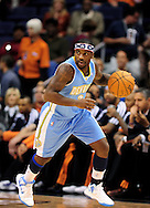 Nov. 12, 2012; Phoenix, AZ, USA; Denver Nuggets guard Ty Lawson (3) handles the ball against the Phoenix Suns at US Airways Center. The Suns defeated the Nuggets 110-100. Mandatory Credit: Jennifer Stewart-USA TODAY Sports.