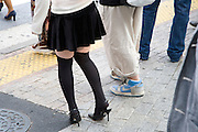 young adult woman waiting to cross the street in the Shibuya district Tokyo Japan
