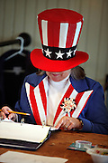 Sanbornton ballot clerk Criss McGee looks up a voter as New Hampshire residents head to the polls to cast their ballot in the first-in-the-nation presidential primary; Tuesday, January 10, 2012. <br /> <br /> (Alexander Cohn/ Monitor staff)