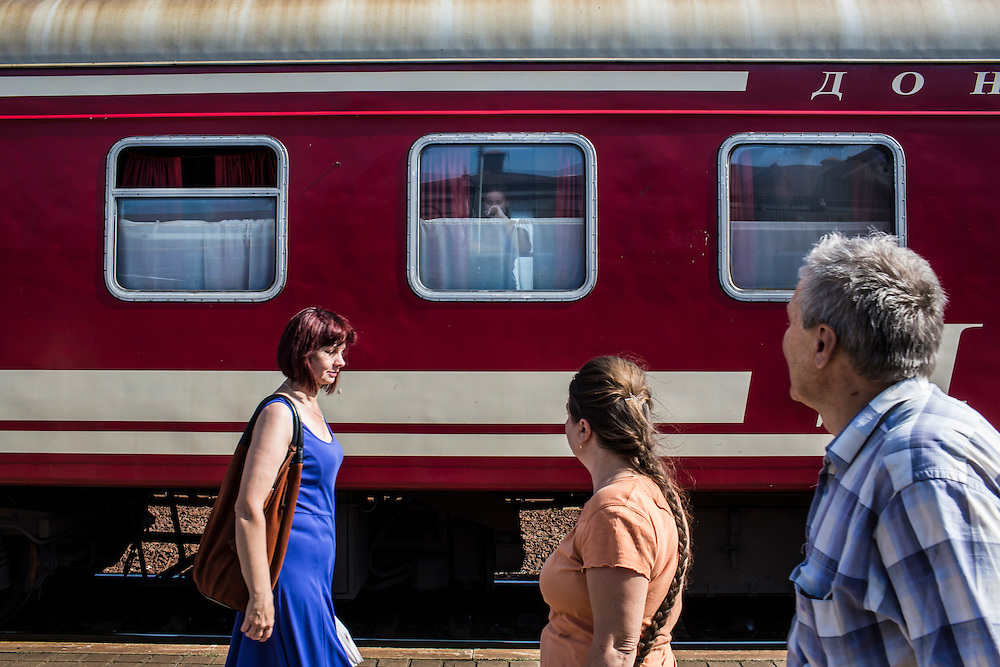A train traveling from Donetsk to Moscow, away from areas with heavy fighting, departs on Monday, July 28, 2014 in Yasinovataya, Ukraine.