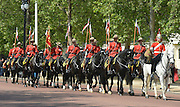 © Licensed to London News Pictures. 23/05/2012. London, UK The Guard makes its way along the Mall. Canadian Mounties Guard Her Majesty the Queen at Horse Guards Parade on Whitehall in Westminster. They will guard on all day and will be the first non-British force to guard the Queen. Photo credit : Stephen Simpson/LNP