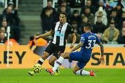 Emerson Palmieri (#33) of Chelsea slides in to challenge Isaac Hayden (#14) of Newcastle United for the ball during the Premier League match between Newcastle United and Chelsea at St. James's Park, Newcastle, England on 18 January 2020.
