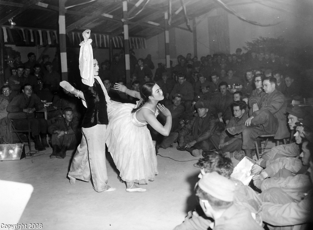 UN forces in Pusan, Korea are entertained with a special show on New Years Eve, December 31, 1950.