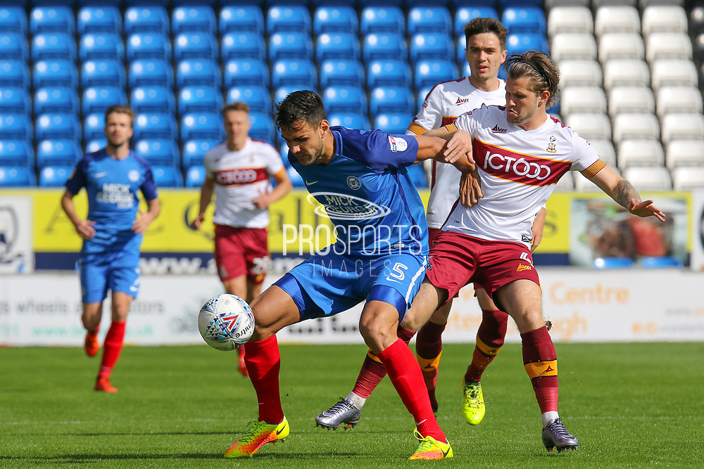 Peterborough United defender Ryan Tafazolli  holds up the ball during the EFL Sky Bet League 1 match between Peterborough United and Bradford City at London Road, Peterborough, England on 9 September 2017. Photo by Aaron  Lupton.