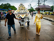 04 OCTOBER 2017 - CHONBURI, CHONBURI, THAILAND: The parade before the water buffalo races. Contestants race water buffalo about 100 meters down a muddy straight away. The buffalo races in Chonburi first took place in 1912 for Thai King Rama VI. Now the races have evolved into a festival that marks the end of Buddhist Lent and is held on the first full moon of the 11th lunar month (either October or November). Thousands of people come to Chonburi, about 90 minutes from Bangkok, for the races and carnival midway.   PHOTO BY JACK KURTZ