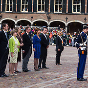 NLD/Den Haag/20130917 -  Prinsjesdag 2013, Voorzitter van de 2e kamer der Staten-Generaal, Anouchka Miltenburg (blauwe jurk) met andere leden groeten het vaandel