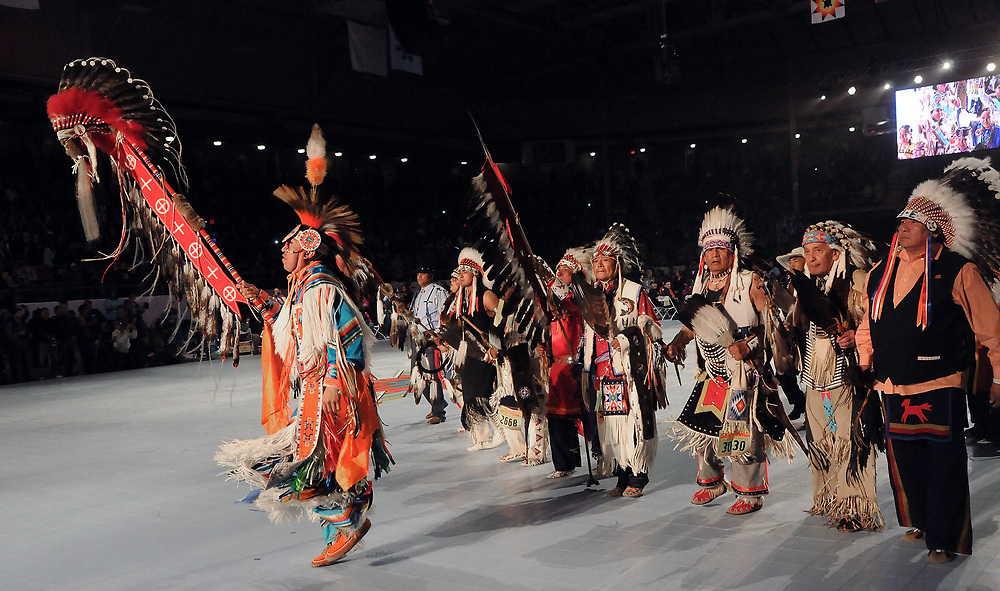 jt042817f/a sec/jim thompson/ Terrance Goodwill of Saskatchewan, Canada carries the Eagle Staff for the Grand Entrance of the 2017 Gathering of Nations Pow-Pow held at Tingley Coliseum.   Friday April 28, 2017. (Jim Thompson/Albuquerque Journal)