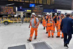 © Licensed to London News Pictures. 07/08/2017. London, UK. Engineering workers on a shift changeover.  Rail passengers face disruption at Waterloo station where nearly half the platforms have been closed until August 28 for a station upgrade.  Photo credit : Stephen Chung/LNP