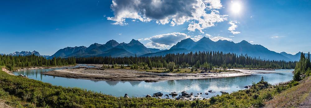 The Canadian Rocky Mountains reflect in the Kootenay River, in Kootenay National Park, British Columbia, Canada. This image was stitched from multiple overlapping photos.