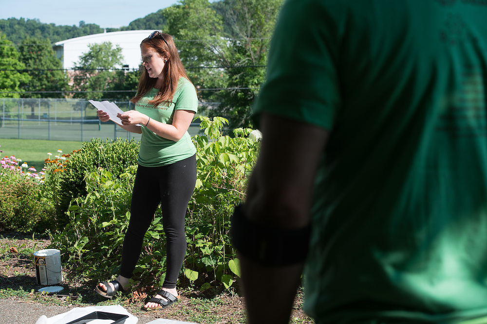 Megan Buskirk, environmental strategies coordinator for Athens City-County Health Department, gives a welcome speech to the volunteers before painting mile markers on the HockHocking Adena Bikeway. © Ohio University / Photo by Kaitlin Owens